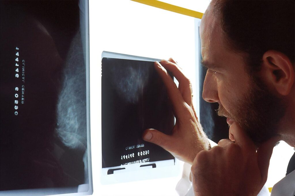 X-Ray technician reviewing results