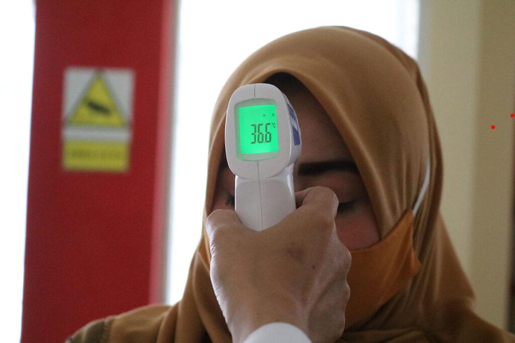 Person checking temperature