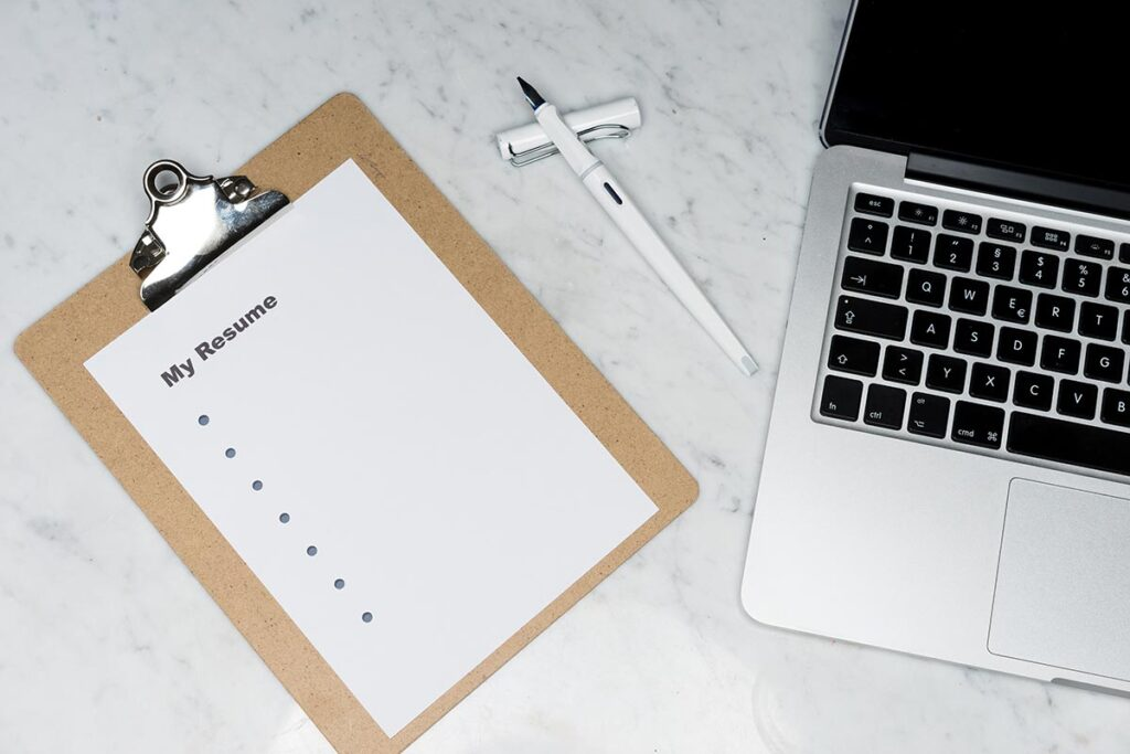 Job searching tools - paper and laptop